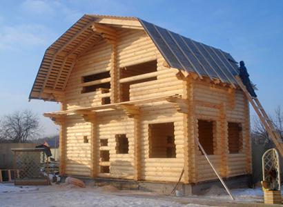 Типовой дом из бревна с мансардой
